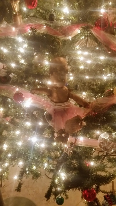 The garden gnome from book 4 is no longer the tree topper - but he seems happy here. (So funny to thing he's made from my neighbor's old panty hose!)